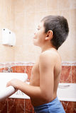 Little boy in bathroom Stock Images