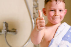 Little boy in the bathroom giving a thumbs up Stock Image