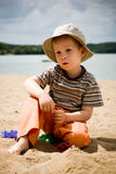 Little boy on beach. Little boy in the hat playing in the sand on the beach Royalty Free Stock Photo