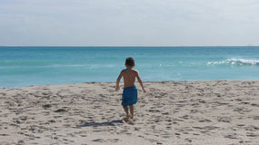 Little boy on the beach Stock Images