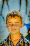 Little boy at the beach. Little Caucasian boy at the beach - head shots Royalty Free Stock Image