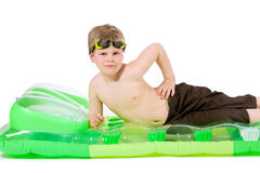 Little boy on beach mattress Royalty Free Stock Photography