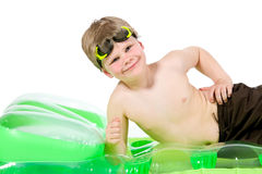 Little boy on beach mattress Royalty Free Stock Photo