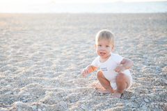 The little boy on the beach at the ocean Stock Photography