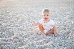 The little boy on the beach at the ocean Royalty Free Stock Photos