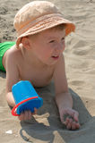 Little boy on the beach. Little boy in panama playing with sand Stock Image