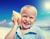 Little Boy Beach Seashell Fun Vacation Concept Royalty Free Stock Image