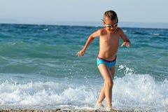 Little boy on the beach Stock Image