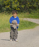 Little boy and bear Stock Image