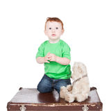 Little boy with bear toy isolated over white Stock Photos