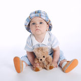 Little boy with bear toy Stock Photo