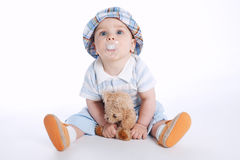 Little boy with bear toy Stock Images