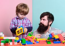Little boy with bearded man dad playing together. child development. happy family. leisure time. building home with. Little boy with bearded men dad playing stock image