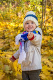 Little boy with beautiful eyes looking up in the park Stock Images