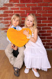 Little boy and beautiful girl with heart Stock Photos