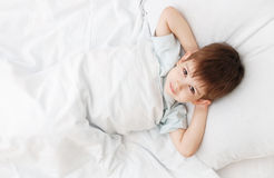 The little boy on a bed Royalty Free Stock Photos
