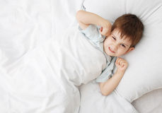 The little boy on a bed Stock Photography