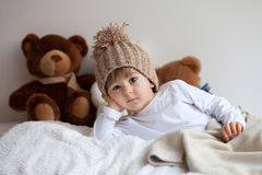 Little boy in bed with teddy bears around Royalty Free Stock Photo