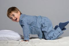 Little boy in bed Stock Images