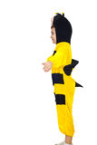 Little boy in bee costume. Child boy stands with hands outstretched in profile and plays the bee wings isolated on white background.Check also Children Royalty Free Stock Image