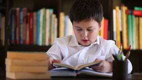 Little boy beeing bored with reading