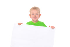 Little boy behind white banner Stock Photography