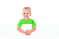 Little boy behind white board Stock Photos