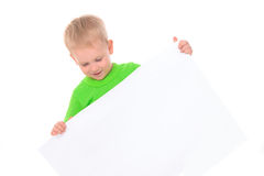 Little boy behind white board Royalty Free Stock Image