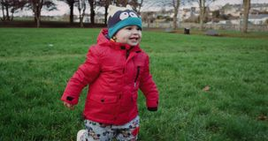 Little boy being adventurous and loving childhood by running through a field exploring. Cinema Camera Red Epic. 4k. stock video