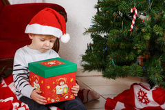 Little boy being happy about christmas present. Royalty Free Stock Photos