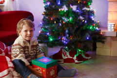 Little boy being happy about christmas present. Stock Photos