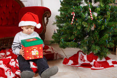 Little boy being happy about christmas present. Royalty Free Stock Image