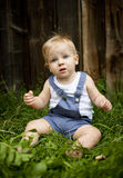 Family on the farm. A little boy being uncomfort and unhappy on the farm Royalty Free Stock Photography