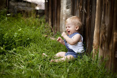 Family on the farm. A little boy being uncomfort and unhappy on the farm Royalty Free Stock Photos
