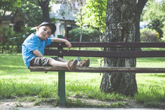 Little boy on a bench. In the park Royalty Free Stock Images