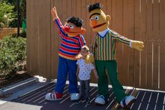 Little boy with Bert and Ernie in Sesame Street area. at Seaworld in International Drive area  2. Orlando, Florida. April 20, 2019. Little boy with Bert and royalty free stock images