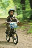 Little boy on bicycle, with blurred background Royalty Free Stock Photo