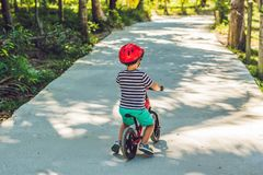 Little boy on a bicycle. Caught in motion, on a driveway motion blurred. Preschool child`s first day on the bike. The joy of move Stock Images
