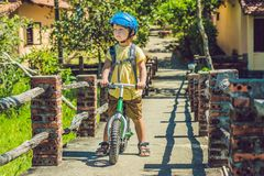 Little boy on a bicycle. Caught in motion, on a driveway motion. Blurred. Preschool child`s first day on the bike. The joy of movement. Little athlete learns to Royalty Free Stock Photography