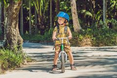 Little boy on a bicycle. Caught in motion, on a driveway motion. Blurred. Preschool child`s first day on the bike. The joy of movement. Little athlete learns to Stock Photography