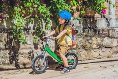 Little boy on a bicycle. Caught in motion, on a driveway motion blurred. Preschool child`s first day on the bike. The. Joy of movement. Little athlete learns to stock photo