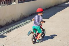 Little boy on a bicycle. Caught in motion, on a driveway motion. Blurred. Preschool child`s first day on the bike. The joy of movement. Little athlete learns to Royalty Free Stock Photo