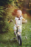 Little boy with bicycle Stock Images