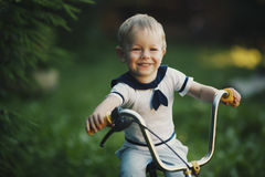Little boy with bicycle Stock Image