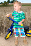 Little boy with bicycle for kids Stock Images