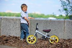 Little boy on a bicycle Stock Photos