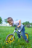 Little boy on a bicycle Stock Images