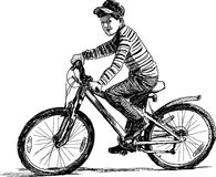 Little boy on a bicycle Stock Photo