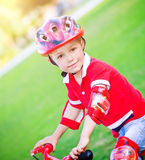 Little boy on bicycle Stock Image