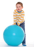 Little boy with a big ball. Stock Images